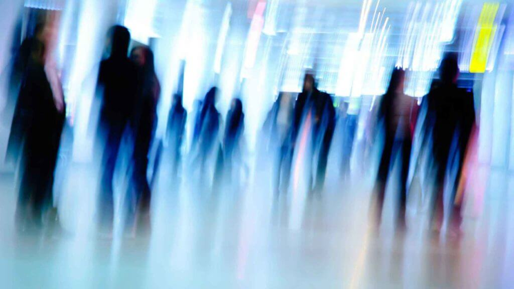 About Us stock-photo-city-business-people-abstract-background-blur-motion-83448859